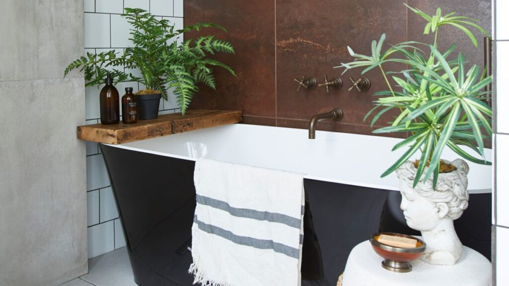 This formerly cramped bathroom is now a gorgeous, houseplant filled space to relax in